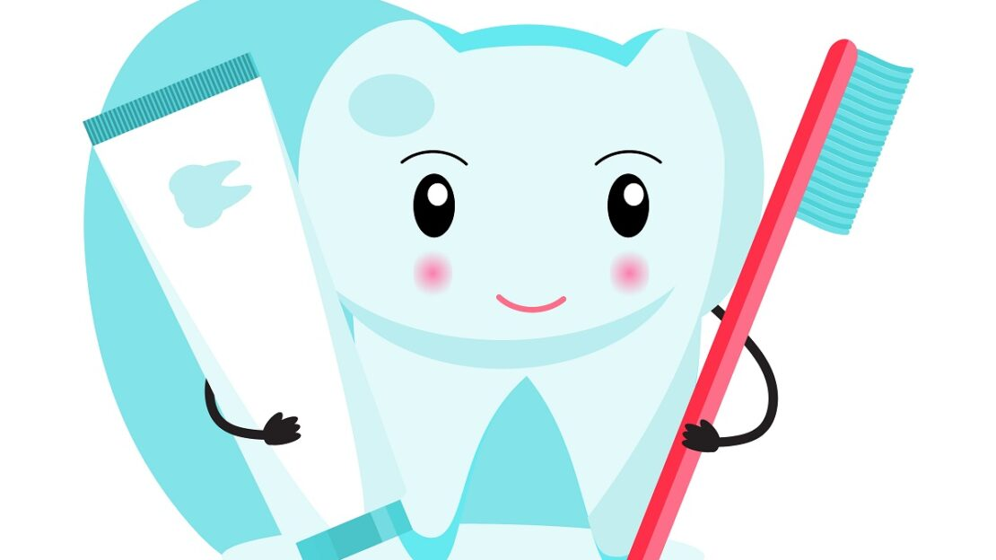 Funny tooth is holding a toothbrush and toothpaste